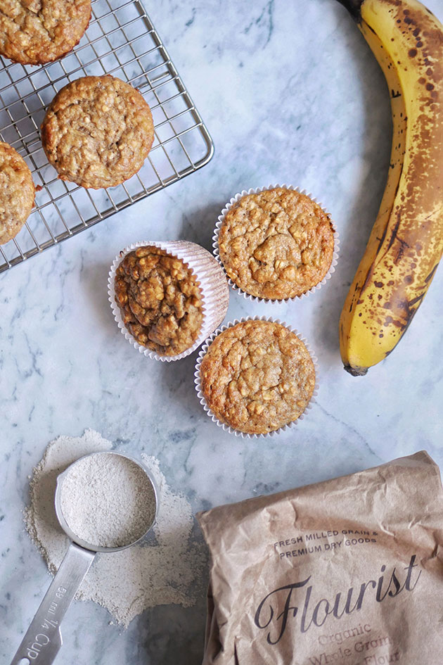 Banana muffins on a marbled counter.