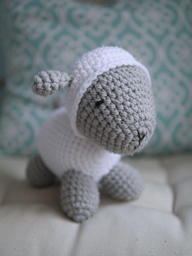 Crochet lamb doll on a chair.
