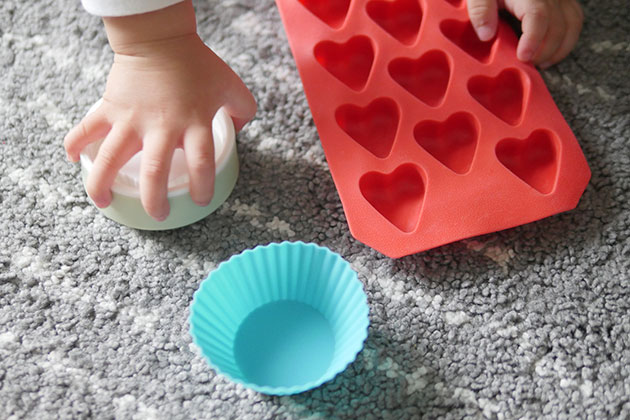 Everyday objects from the kitchen for baby to play like silicone cupcake liners and ice cube.