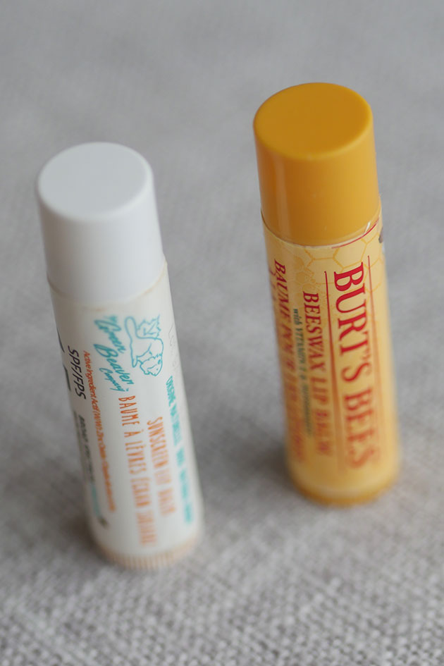 2 clean lip balms shown standing on a counter, contains natural ingredients that are safe for pregnancy and fertility.