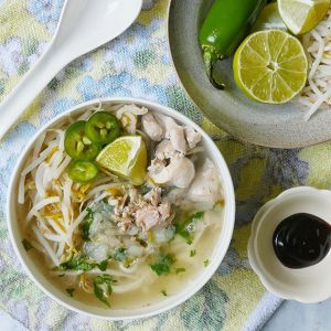 close up of chicken pho soup with all the condiments