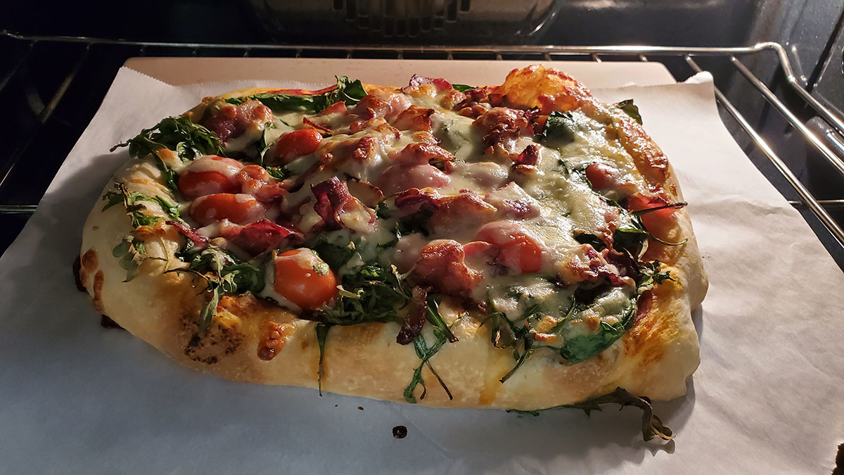 Homemade pizza being baked in the oven.