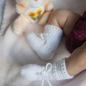 close up of newborn baby feet sleeping.