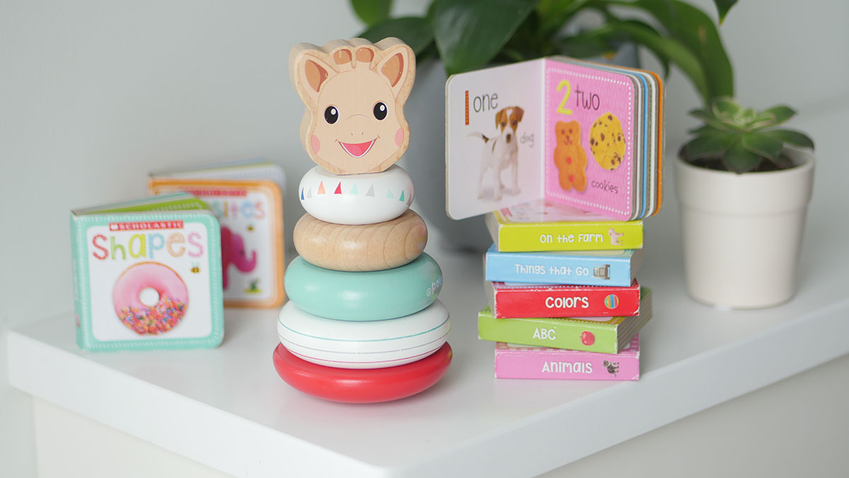 Wooden baby toddler toy with mini books.
