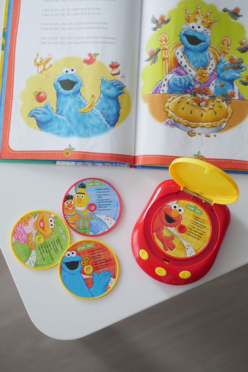Close up of Elmo music player for baby toddler with song book and mini disks.