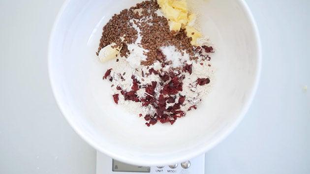 Mixing all the sourdough crackers inside a big bowl.