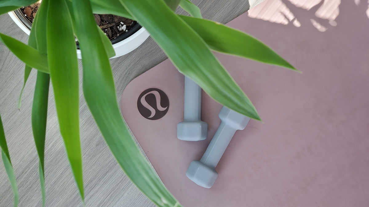 Exercise weights on a yoga mat.